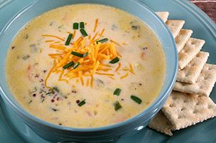 You've never had cheesy cauliflower soup like this! Its powerhouse partners in deliciousness are kale, quinoa and cut-up pieces of bacon.