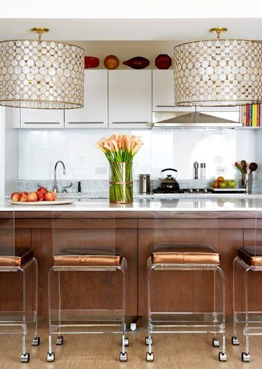 DRUMSHADES  Nice kitchen, dramatic oversized lighting, but what I really love is...those lucite counter stools!!  Check those babies out!!!  I need to get me something, ANYTHING lucite...another trend I'm late to the party for!!