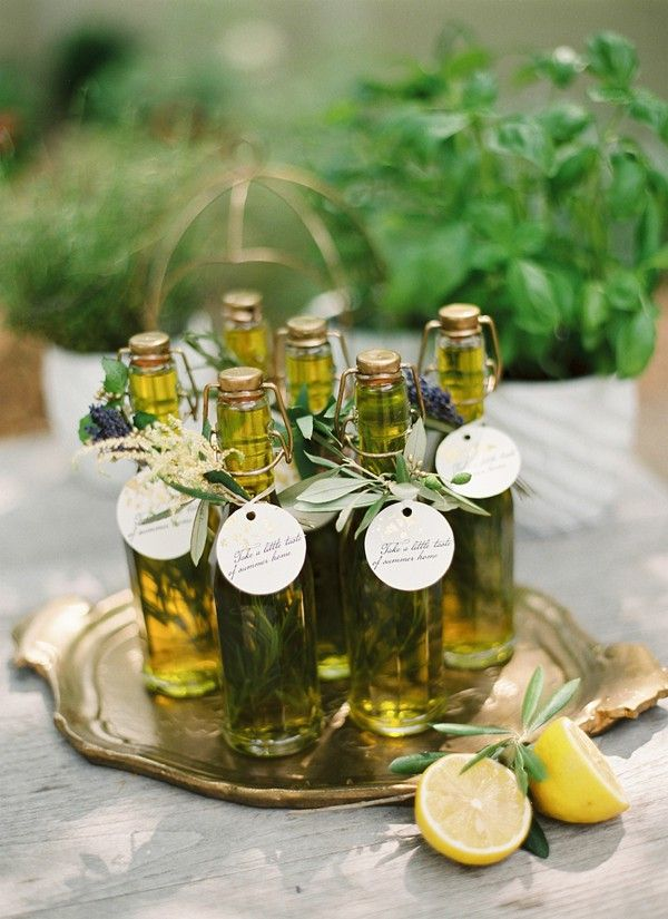 Herb olive oil as favors (DIY!) Glass bottles, olive oil & sprigs of rosemary.  1) Place 1 sprig of rosemary in each bottle. 2) Using a small funnel to prevent spillage, pour the olive oil into the bottles. 3) Finish off with a favorite ribbon and you're ready to go!