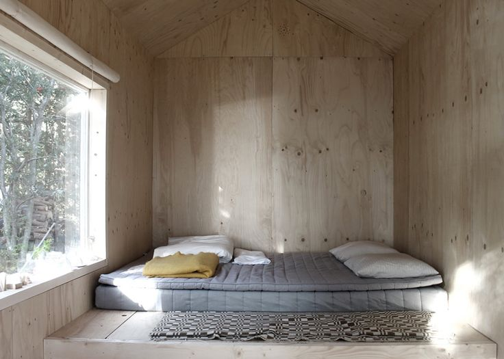 love this sleeping space in a plywood cabin.