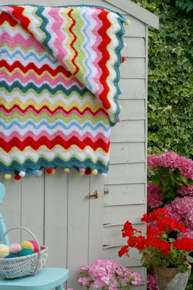 Coco Rose Diaries crochet ripple blanket inspiration, made with various cheap acrylic yarns, according to maker.