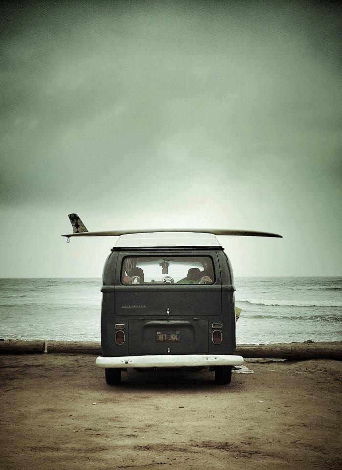 Vintage camping car (probably a Westafalia) with a surf board on top AND in front of the sea.. that's my dream, can you imagine something better?