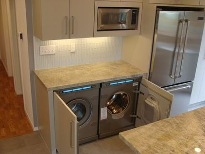 washer/dryer in the kitchen. Great idea for a small home.