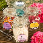 This site has some cute little containers/jars to personalize for weddings.