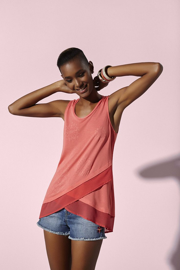 Women's coral red T-shirt with a double crossover hem.