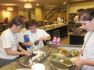 Member of the team at Hyatt Regency Chicago work to prepare dinner or the families at Ronald McDonald House Chicago.