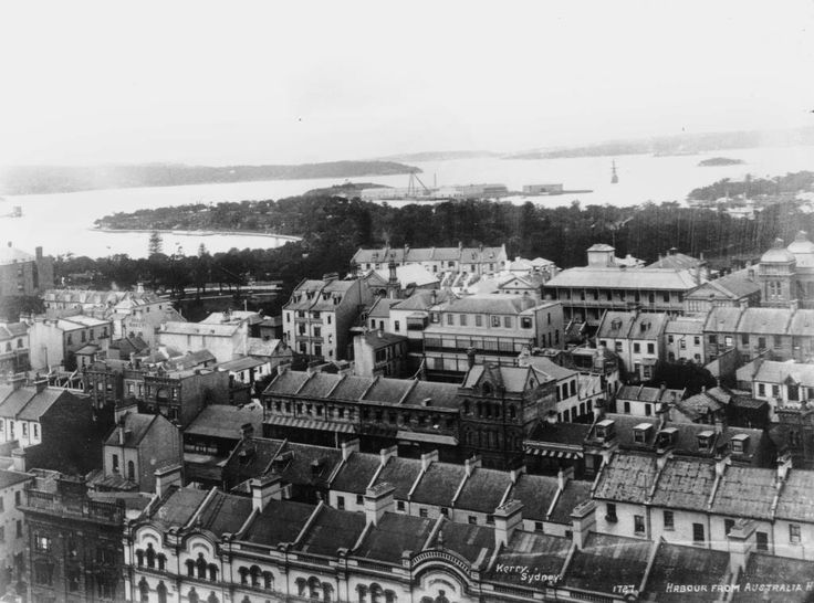 Terraced buildings,now mostly demolished,looking towards the Royal Botanic Gardens, Bennelong Point and garden island in the background before it became a peninsula 1920.