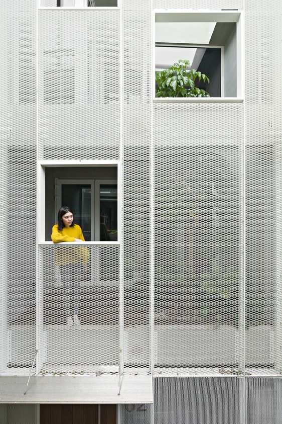http://inspirationist.net/a-house-in-taipei-designed-inwards-and-upwards/
