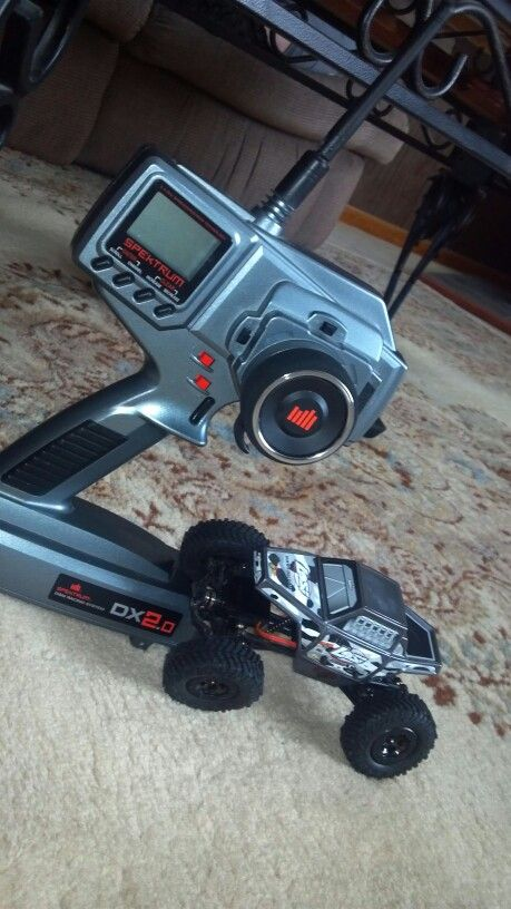 Losi micro crawler rolling on a set of Mickey Thompson Baja Claw replicas. All controlled by a Spectrum DX2.0