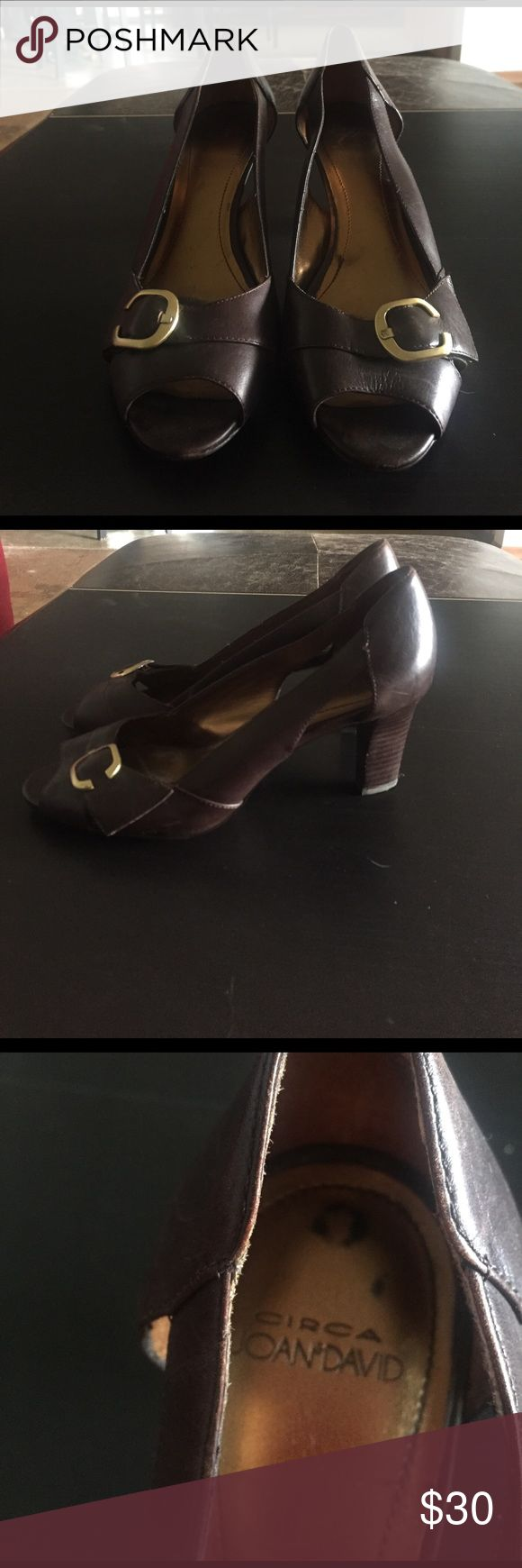 Circa Joan& David brown leather open toe pumps Dark brown leather Marisa pump from Circa Joan & David size 7m. Gold buckle on the toe, heel height is 2 1/2 inches, heel is sturdy and comfortable to wear. Great for business. Worn once for a meeting, like new inside of the insole has markings from where the gold paint wore off after first wear. Joan & David Shoes Heels