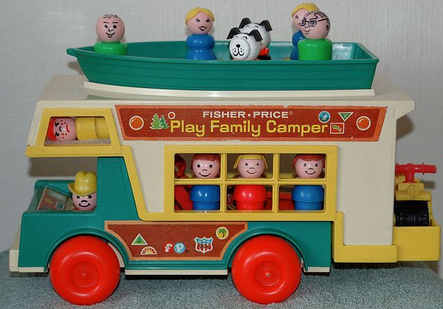 """My favorite """"child"""" is up in the bed. I call him """"Sour Face"""" Love him and i still have him. (fisherprice camper family)"""