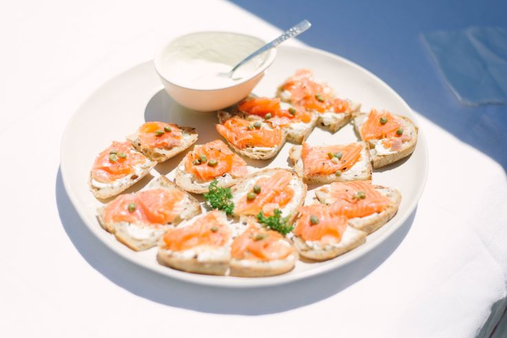 Christmas Lunch, salmon on bread with capers, parsley and cream cheese.