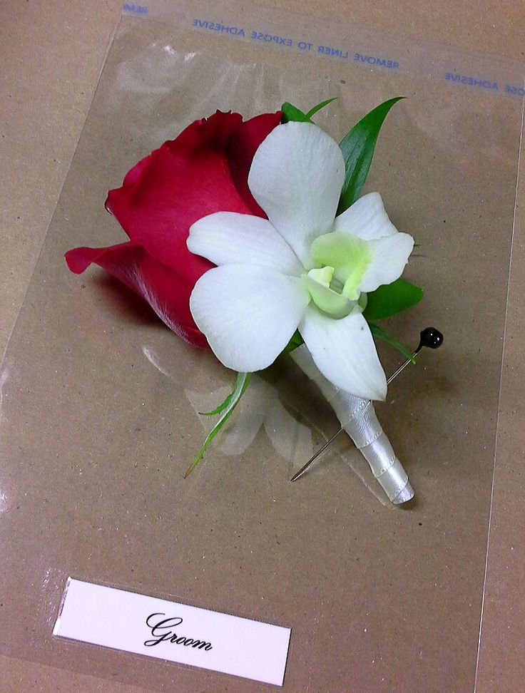 Grooms red rose and dendrobium orchid boutonniere; design by Davis Floral Creations