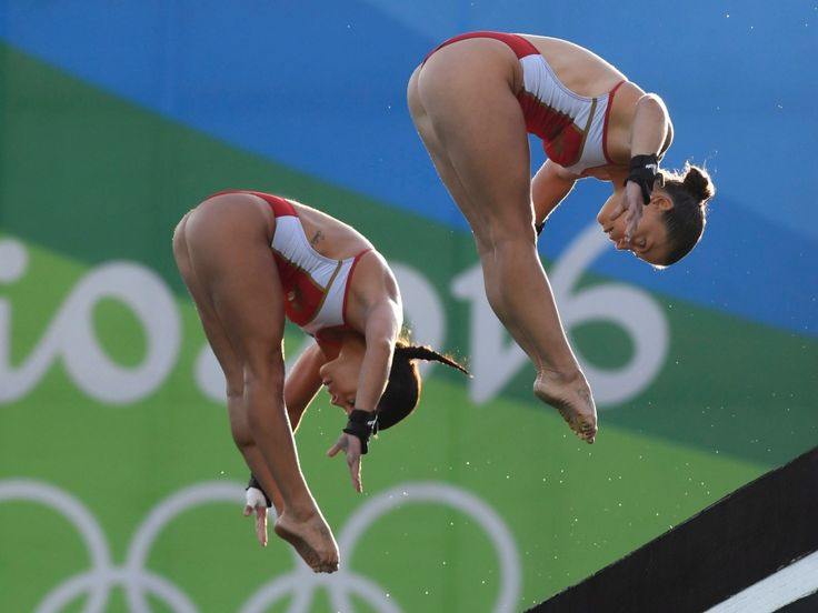 Canada's Meaghan Benfeito (left) and Roseline Filion perform in the women's synchronized 10-meter platform diving final at the 2016 Summer Olympics in Rio de Janeiro, Brazil, Tuesday, Aug. 9, 2016 THE CANADIAN PRESS/Frank Gunn