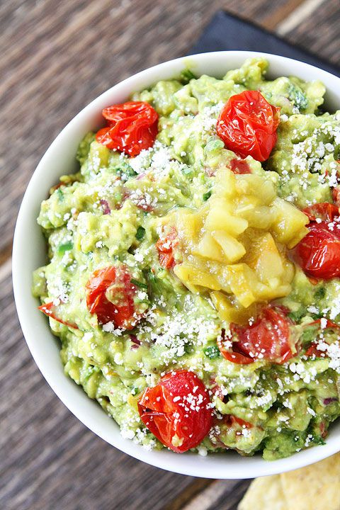 Green Chile and Roasted Tomato Guacamole Recipe on twopeasandtheirpod.com This guacamole is loaded with flavor! #avocado #appetizer