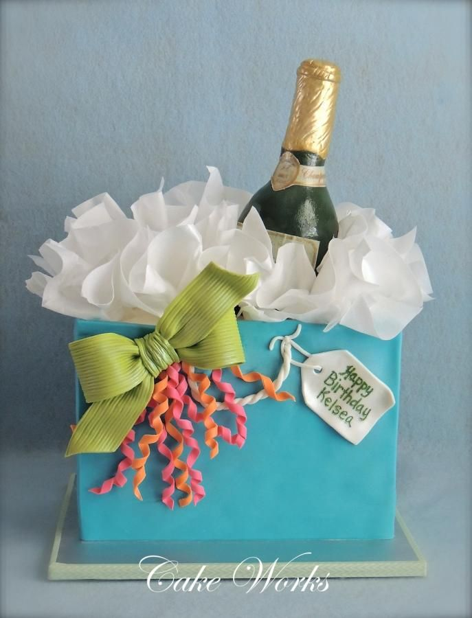 Champagne in a gift bag for a 21st birthday. Champagne bottle is RKT covered in fondant.