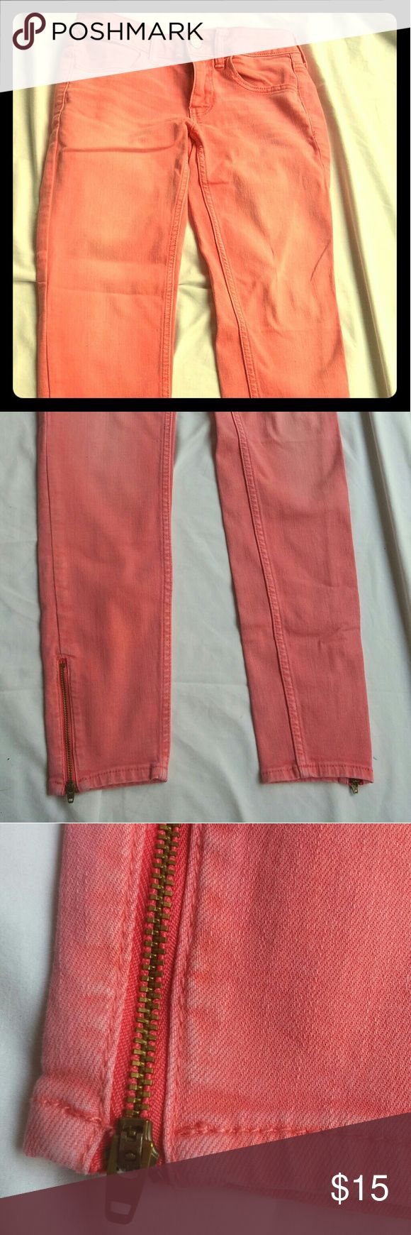 American Eagle Light Coral Skinny Jeans Light washed coral super stretch skinnies with zippered leg detail from American Eagle. Great shape, hardly worn. Comes from a nonsmoking environment. American Eagle Outfitters Jeans Skinny