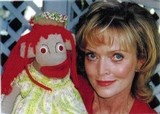 Courtesy Peggy Mitchell  ABOVE: Peggy Mitchell is shown here with her puppet Ezmarelda in 2004. The former Evansville TV hostess died Tuesday. TOP: Mitchell and Carl Vaughn, portraying Clancy the Cop, on 'The Peggy Mitchell Show' on WEHT-News 25, which ran from 1961 to 1986.