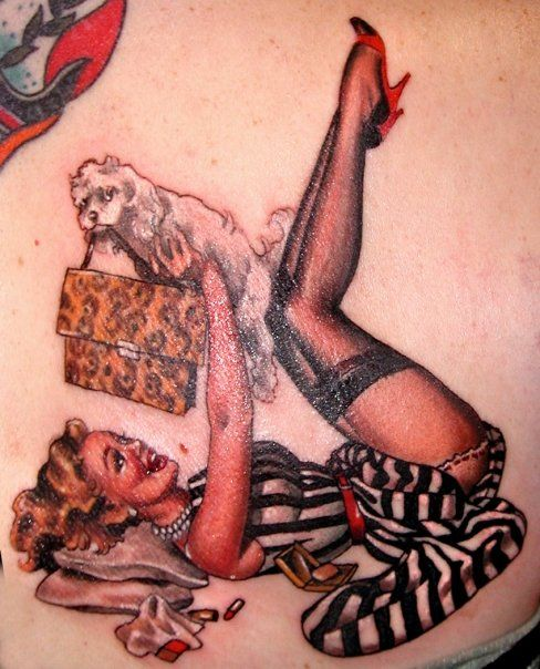 Pinup tattoo by Hannah Aithison. I've been watching a lot of LA Ink lately, and I really like all of the things Hannah has done on the show