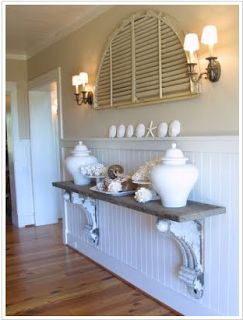 Lovely pure white conch shell like Urn, Starfish & other shells & conches gives this hallway a beachy charm