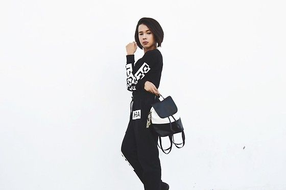 Get this look: http://lb.nu/look/8133084  More looks by Kylie Rodriguez: http://lb.nu/itsthekyliebabii  Items in this look:  Divided By H&M Black Top, Hba Black Jogger Pants, Jukaykay Black And White Backpack   #casual #minimal #sporty #fashion #fashionblogger #fblogger #philippines #manila #monochrome