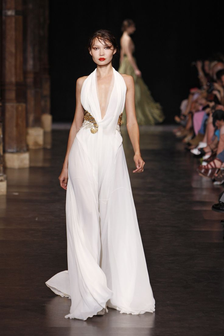 Floor length with deep V-neckline white gown