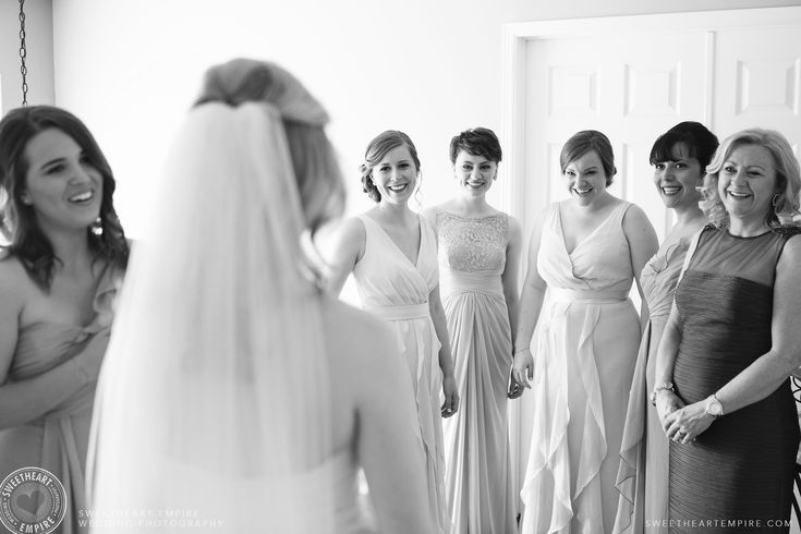 Bridesmaids and mother of the bride seeing Vanessa in her wedding gown and veil for the first time. Oakville wedding photographer #sweetheartempirephotography
