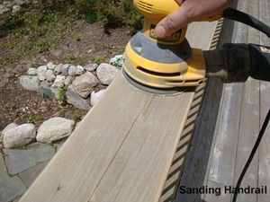 This tutorial will describe how to sand a wood deck after power washing where wood grain may have been raised and in preparation of final staining and finishing.: Sanding the Handrail