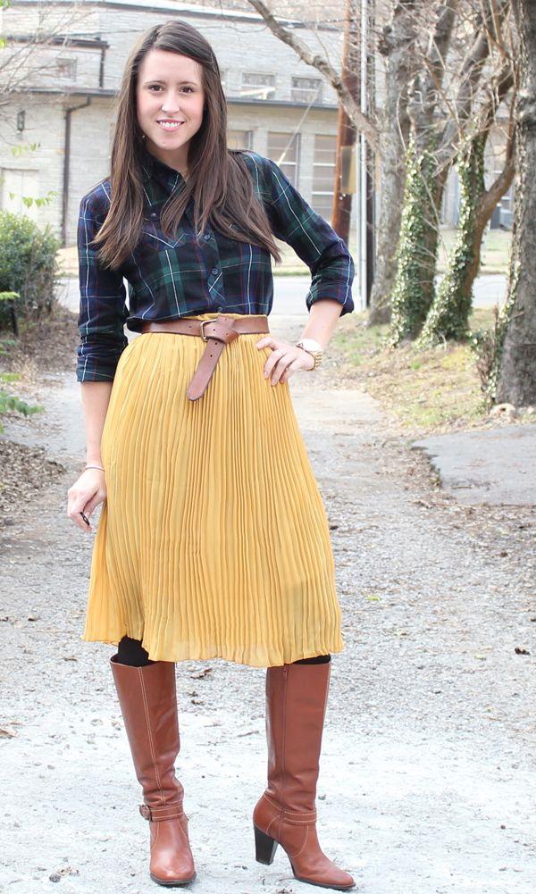 mustard midi skirt, plaid shirt, belt, boots