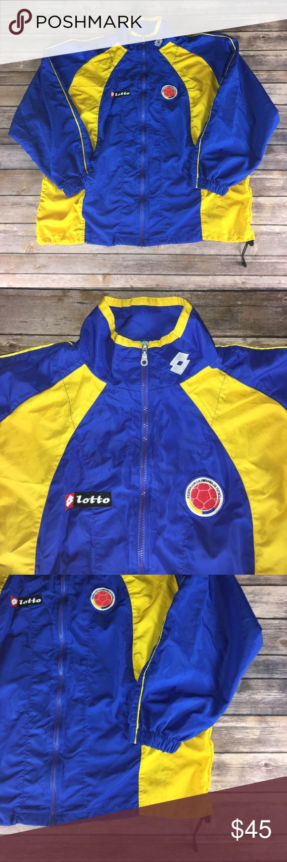"""BLUE & YELLOW LOTTO COLUMBIA FUTBOL WINDBREAKER Like new condition. No stains or flaws. Full zip. Two front pockets. Drawstring on bottom. Tag unreadable. Fits like a L/XL. Chest 27"""" 