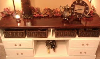 Dresser repurposed into dining room buffet - love the removal of center drawers for wine storage!