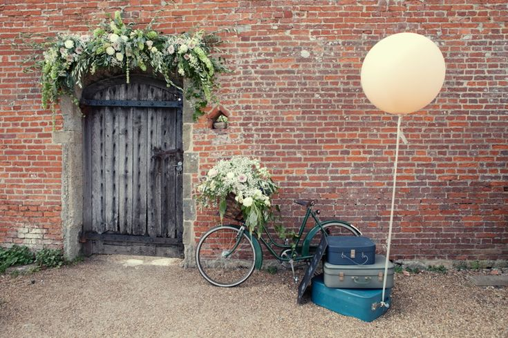 Image by Horseshoe Photography - Vintage Inspired Stylish Wedding At The Walled Garden Cowdray With Bride In San Patrick Dress And Jimmy Choo Shoes And A Malene Birger Sequinned Jacket And Groom In Navy Suit From Topman With Oversized Floral Crowns For The Bridesmaids