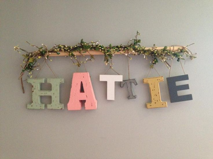 Nursery wall name wall art. Letters from Micheal's art store, wooden dowel, garland and twine string. EASY!