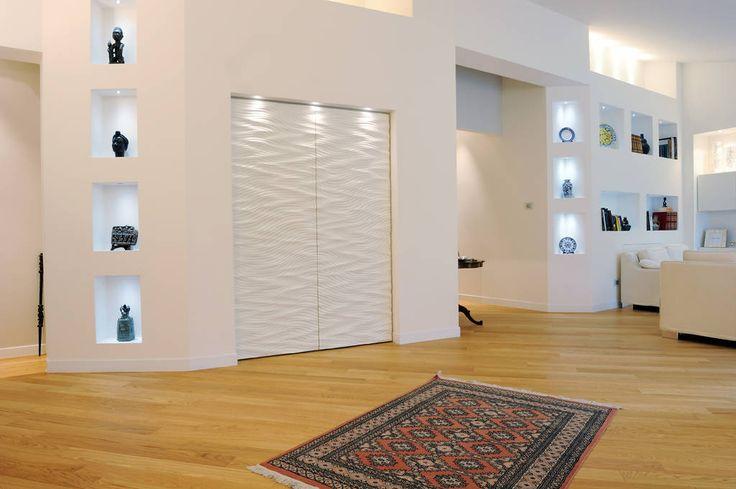 ... di luce a Ravenna : Soggiorno moderno di Atelièr di progettazione