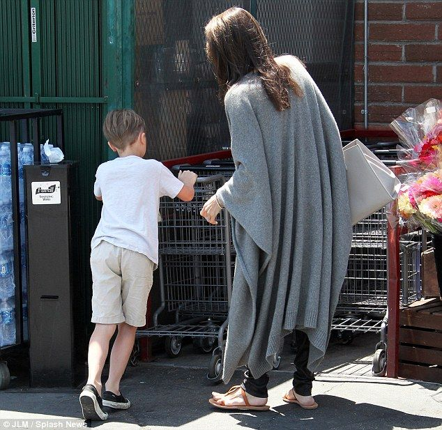 In charge: She made sure that Knox put the shopping cart back into the holding area with o...