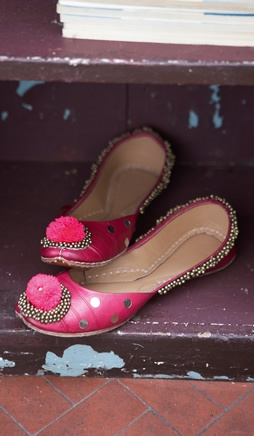 Indain dance shoes.   Deep pink leather Indian shoes with gold beadwork and a pink pompom on the toe.
