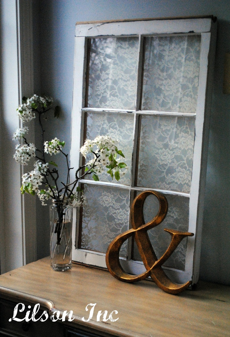 I love the lace behind the window.  Paint it wisteria.  Place flowers on the side.  Really  sweet.