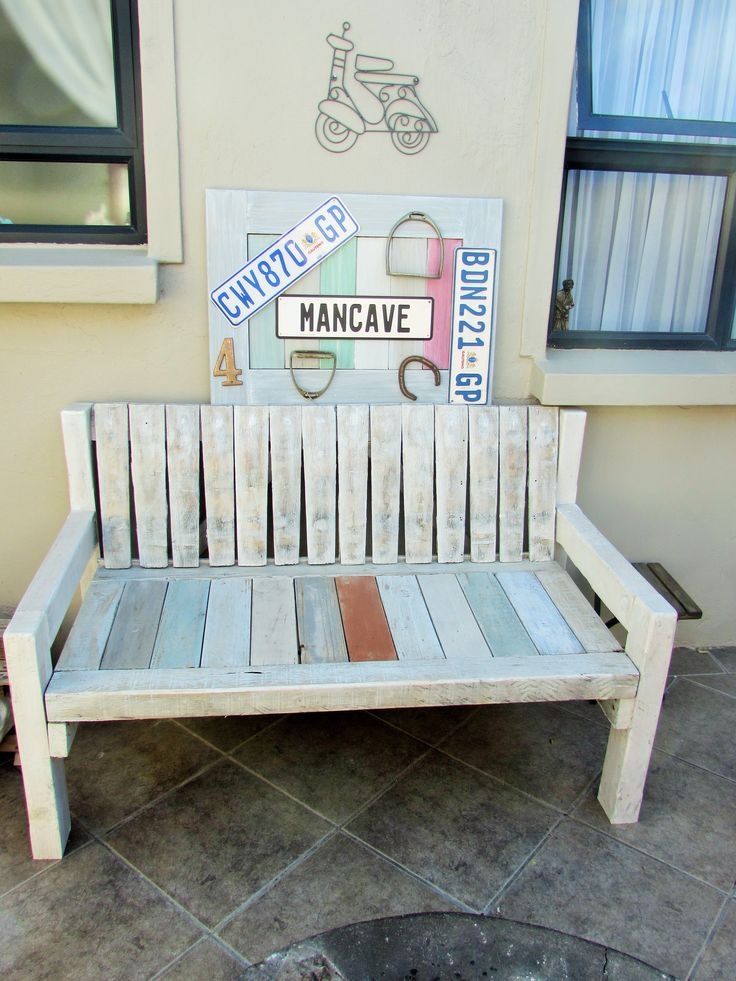 Courtyard bench made out of pallet and wine barrel wood.