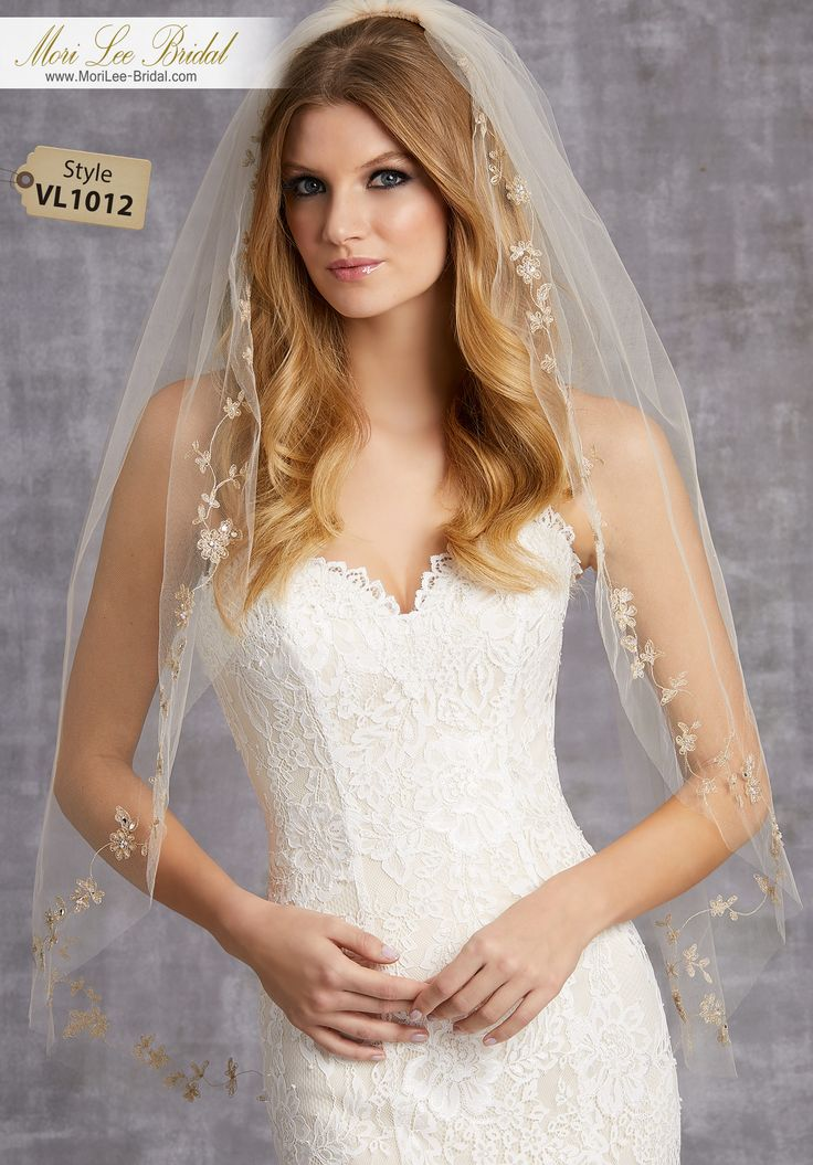 Style VL1012Veil with Embroidered Edge of Pearls and RhinestonesAvailable in Fingertip Length (VL1012F) Shown, or Cathedral Length (VL1012C). Colors: White/Silver, Ivory/Silver, Ivory/Gold, Gold/Gold.