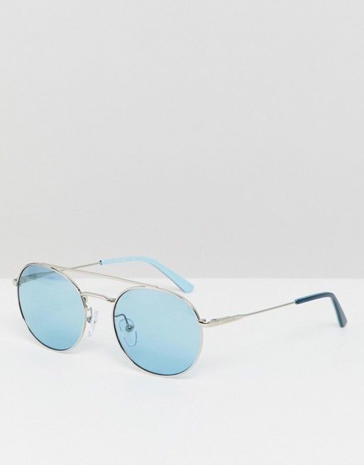 6d6edc1317 Calvin Klein CK18116S round sunglasses with blue lens in 2019 | buy ...