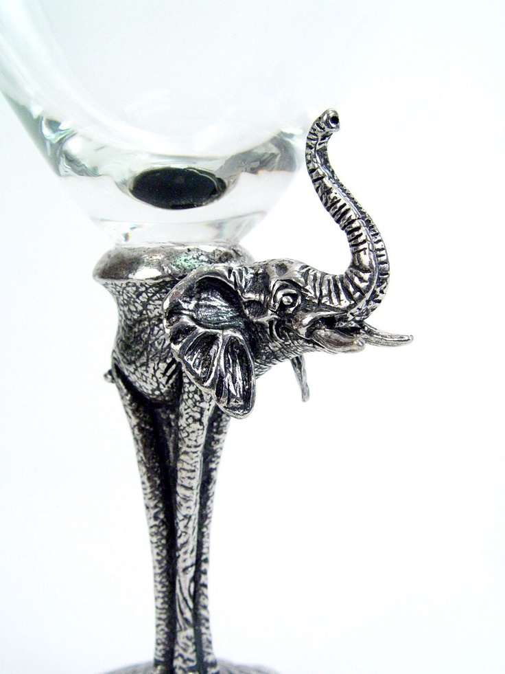 Elephant Martini Glass - These beautiful glasses are made out of glass and pewter.  The elephant signifies strength, royalty, dignity, patience, wisdom, longevity, and happiness. Highly revered for its intelligence, the elephant also has a strong sense of loyalty and community. A powerful symbol of good fortune, keeping a lucky elephant in your home is thought to protect you from bad luck and stimulate prosperity in your life.  $29.00