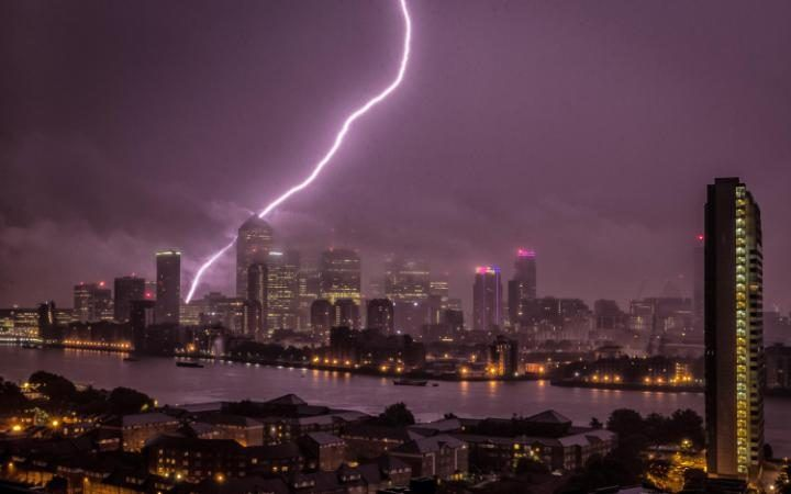 A huge bolt of lightning strikes Canary Wharf in London