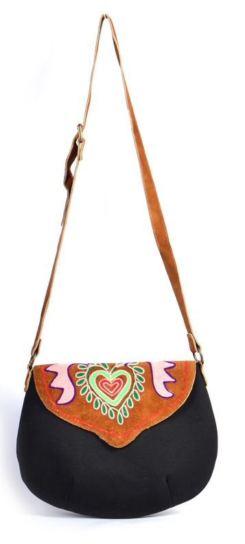 #styleincraft #Antiquecollection #Handmadebags #Handmadeitems  This Small Cross Body Corduroy and Printed Canvas Bag is apt for everyday use. Made for the fashion savvy girl of today, this bag can be paired with any trendy or casual outfit to sport a stylish look. It has an adjustable strap.