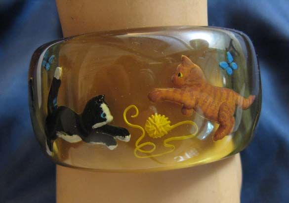 Incredibly cute reverse carved kitten themed Bakelite bangle bracelet (this is over-the-moon awesome!).