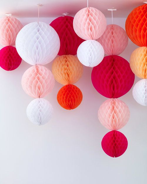 String together store-bought paper decorations in various colors and sizes to create a showpiece full of visual interest.