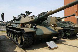 type 74 nana yon | JGSDF Type74 tank (Public Information Center).jpg