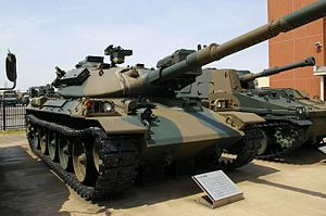 type 74 nana yon | JGSDF Type74 tank (Public Information Center).jpg