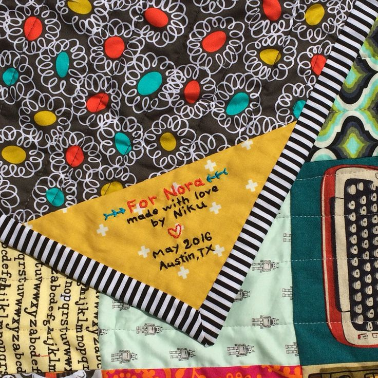 Corner quilt label for Nora's baby quilt.