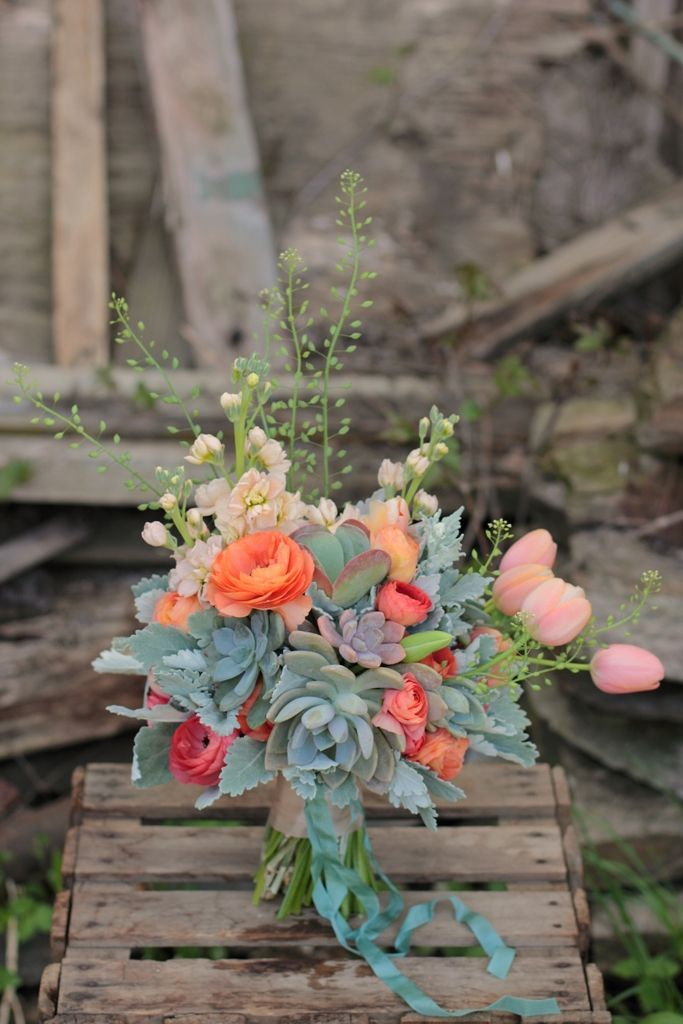 Real Wedding :: Sheila Raynor. There were a dozen succulents including hot lips paddle plant tucked among the ranunculus, tulips, stock and dusty miller. Love the whimsy of the wild mustard seed spikes.