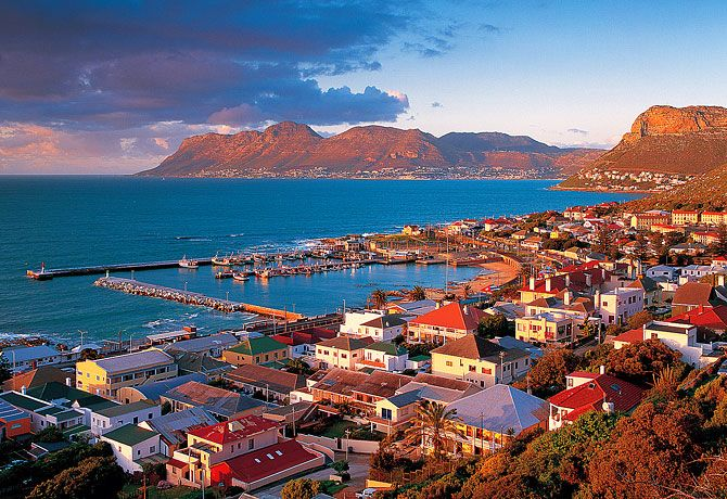 Kalk Bay is a few minutes drive out of Cape Town City. Go there to eat fish and chips right next to the ocean.  http://www.capeletting.com/a-day-in-kalk-bay-and-simonstown